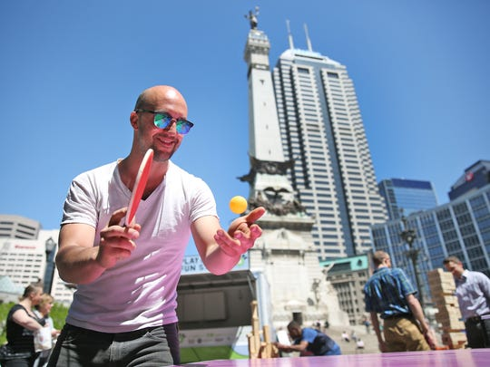 Michael Runge plays ping pong during fun on Monument Circle as part of Downtown Indy's Workforce Week, Monday, April 24, 2017.