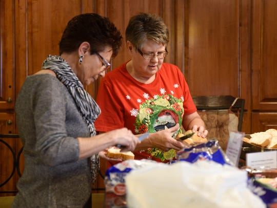 Marlene Wheeler and Ione Reynolds prepare a traditional Christmas dinner at the Gorecki Guest House Monday, Dec. 25, in St. Cloud.