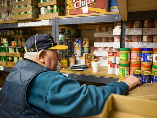 Helping Hands Food Pantry volunteer Ray Winters, 85,