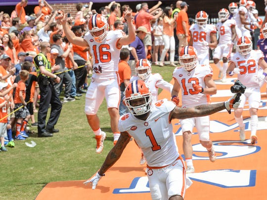 Clemson cornerback Trayvon Mullen (1)  and Will Swinney run down the hill before the spring game in Memorial Stadium in Clemson on Saturday, April 14, 2018.