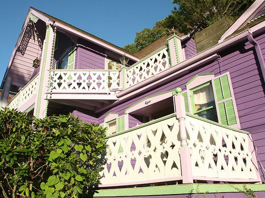 The Rothman home in Mt. Tabor--Color, angles and ginger bread porches are all part of the make-up of this home.