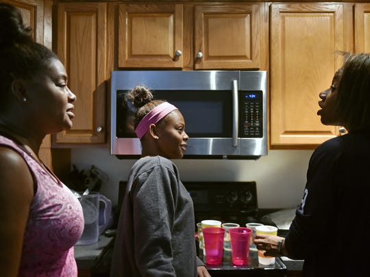 Tania Thomas, left, and daughters Trinity, 16, and Tesia, 14, debate smoothie drink ingredients in their West Manchester Township kitchen Friday, Sept. 1, 2017. Sisters Trinity Thomas, 16, and Tesia Thomas, 14, are different athletes in their own right, but each excels in her chosen discipline. Trinity Thomas is a gymnast on the U.S. senior national team who will attend Team USA's selection camp this month for a shot at a place on the squad for the world championships. Tesia Thomas is a standout three-season athlete for West York, where she plays volleyball, swims and is on the track and field team.