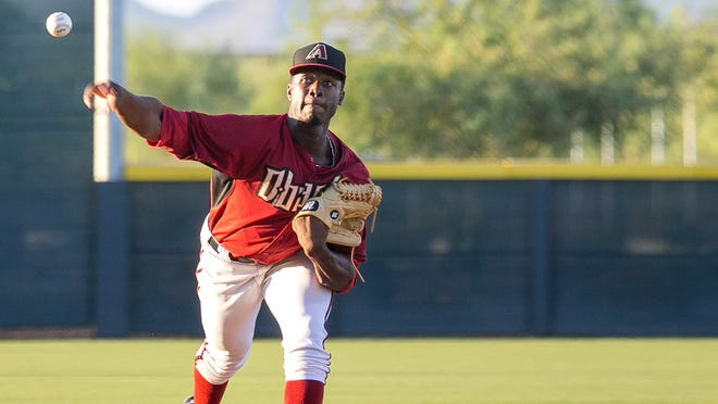Touki Toussaint, 18, pitches during his professional debut with the Arizona Diamondbacks' Arizona Rookie League team at Salt River Fields at Talking Stick on Wednesday, July 2, 2014.