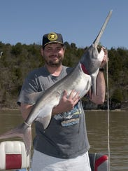 A happy snagger with a spoonbill he hooked on an earlier