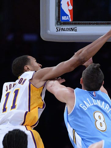 Lakers forward Wesley Johnson dunks over Nuggets forward