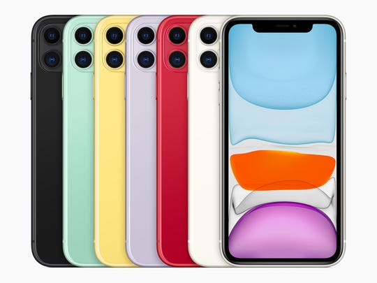 Seven iPhone 11s in different colors, displayed in an overlapping row.