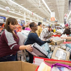 Customers go through sheet sets at Walmart's Black Friday shopping event on  Nov. 26, 2015, in Rogers, Ark. More people shopped online over the holiday weekend than in stores, according to the National Retail Federation.