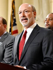 Gov. Tom Wolf speaks before he signs the medical cannabis bill into law in the rotunda of the Capitol in Harrisburg, Sunday, April 17, 2016. Dawn J. Sagert photo