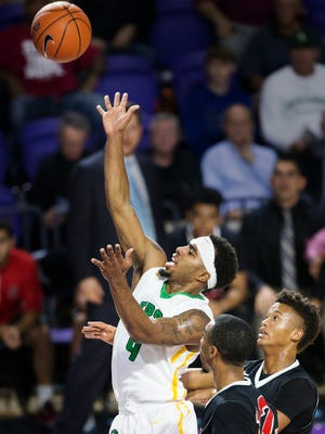 Patrick School's Jamir Harris scores against Sagemont during play Friday at the Culligan City of Palms Classic at the Suncoast Credit Union Arena in Fort Myers. Patrick beat Sagemont 80-62.