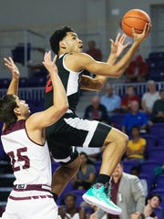 Putnam Science's Eric Ayala scores against St. Anthony during play Sunday at the Culligan City of Palms Classic at the Suncoast Credit Union Arena in Fort Myers.