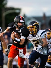 PalmyraÕs Grant Haus looks to escape Elco's Jeff Lorah as Palmyra rolled over Elco 35-7 on  Friday, Sept. 8, 2017.