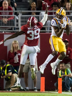 LSU wide receiver D.J. Chark (7) catches a pass over Alabama defensive back Levi Wallace (39) in first half action at Bryant Denny Stadium in Tuscaloosa, Ala. on Saturday November 4, 2017. (Mickey Welsh / Montgomery Advertiser)