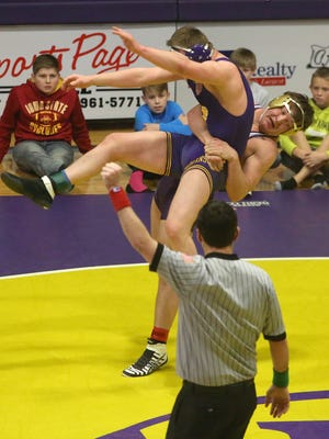 Norwalk's Nate Heckart tries to throw Indianola's Reece Bowlin in a 195-pound match. Bowlin won a 4-2 sudden victory in the first extra period. Norwalk won a Jan. 25 dual at Indianola 51-23.
