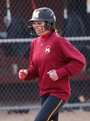 Kendra Hutchison of McCutcheon heads for home after