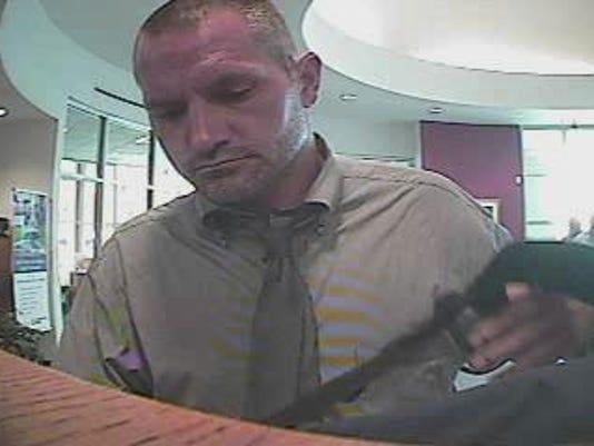 635709340034229658-robbery-suspect-