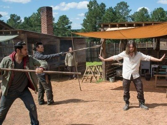 Peter Zimmerman, left, as Eduardo in a scene from The Walking Dead. Zimmerman lived in Montgomery as a child, before moving to Atlanta at 16 to pursue an acting career.