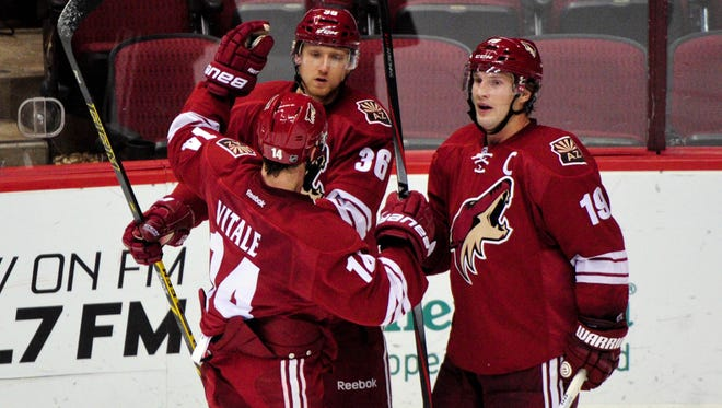 Oct 3, 2014: Coyotes left wing Rob Klinkhammer (36) celebrates with right wing Shane Doan (19) and center Jeff Halpern (14) after scoring a goal in the third period against the San Jose Sharks at Gila River Arena.
