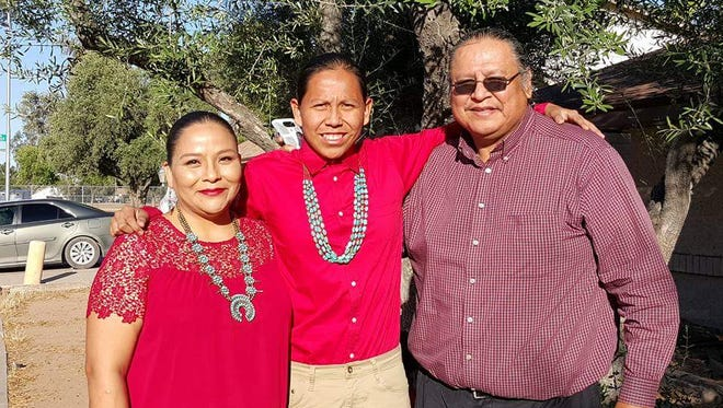 Freddie Johnson (right) and his wife, Cheron, will mark the Aug. 21, 2017, solar eclipse by not watching it. Their son Dwayne (center) will miss his first day of college so that he can stay home with his family in Mesa.The Johnsons, like other Navajos, believe the eclipse is sacred and should not be viewed.