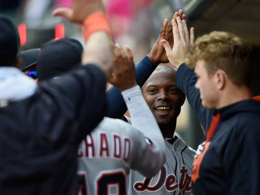 Tigers leftfielder Justin Upton celebrates scoring