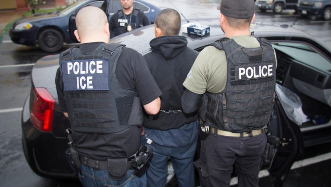 Immigration and Customs Enforcement officers arrest foreign nationals Tuesday during a targeted  operation in Los Angeles on Feb. 7, 2017.