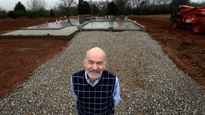 Bill Tucker poses for a photograph in front of his new home that is under construction in the Homestead subdivision in Columbia. Tucker is the first home buyer in the subdivision and is downsizing from his home in Franklin.