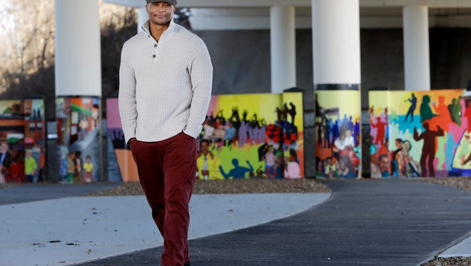 Former Tennessee Titans running back Eddie George poses for photos at an urban improvement project designed and constructed by his landscape and design company, The Edge, in Nashville, Tenn. George is one of many pros who become entrepreneurs when their playing days are over.