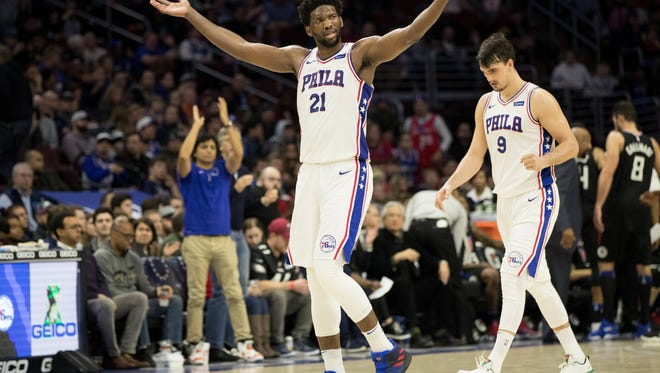 Philadelphia 76ers center Joel Embiid (21) and forward Dario Saric (9) are two big reasons the team is in prime position for a playoff run