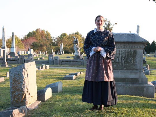 Esther Lewoczko plays the ghost of Corinna 'Miss Pet' McCorry Friday at the annual Downtown Ghosts-A-Walking Tour.