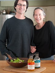 Claire and Netaka White in their Salisbury kitchen on Wednesday April 16, 2014 after preparing a salad dressing made from the canola and sunflower oil from Netaka's company, Full Sun. The oil is pressed from New England and New York-grown seeds.