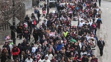 """Hundreds of people march along W. Vernor Hwy. in Detroit on Thursday February 16, 2017 after the """"Day Without Immigrants"""" rally at Clark Park in southwest Detroit."""