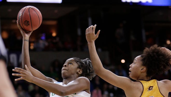 Oregon forward Ruthy Hebard (24) shoots in front of Central Michigan forward Tinara Moore (2) during the first half in a regional semifinal at the NCAA women's college basketball tournament, Saturday, March 24, 2018, Spokane, Wash.