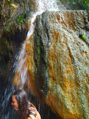 Relaxing under a hot springs waterfall in Costa Rica