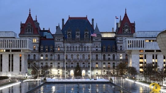 Exterior view of the state Capitol before sunrise on the opening day of the 2019 legislative session Wednesday, Jan. 9, 2019, in Albany, N.Y.