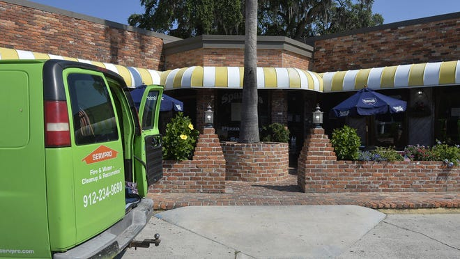 A Servpro van sits outside of Spanky's southside on Monday. The restaurant announced last week that it would close temporarily for cleaning after an employee tested positive for COVID-19. The restaurant has asked all employees to get tested and not return with a negative test.