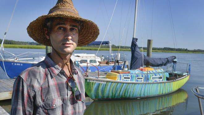 "Andre Bertolino with his sailboat ""Kai"" docked at Young's Marina on Wilmington Island."