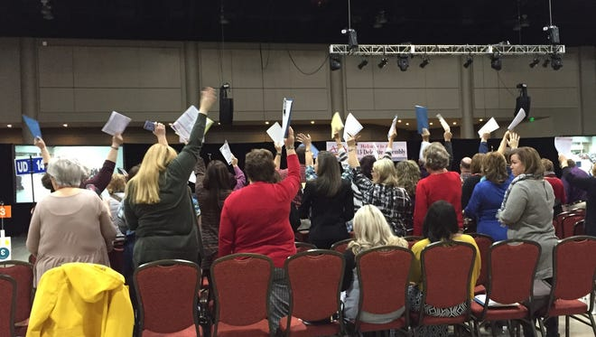 AEA delegates vote in favor of changes to the organization's constitution on Dec. 4, 2015 at the Renaissance Hotel in Montgomery. The new amendments will give the AEA's Board of Directors more oversight in financial matters.