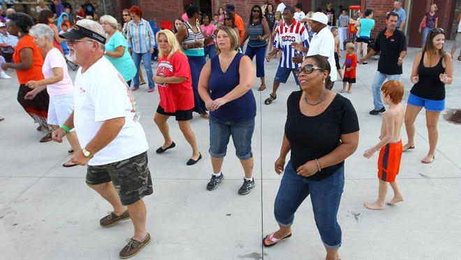 People dance together during Block Party at Carolina Wren Park.