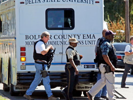 Law enforcement walk across the Delta State University