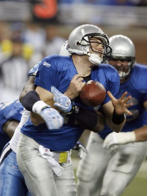 Lions backup QB Drew Henson lost the ball on this hit from behind, which the Lions recovered, during their 47-10 loss to the Tennessee Titans at Ford Field on Nov. 27, 2008.
