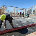 A construction crew works to build a Miramont concept fitness center at the Jsesup Farm Artisan Village Tuesday near Timberline Road and Blackbird Drive in Fort Collins.