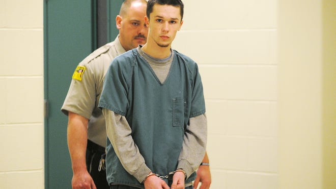 Conner Byron Hanson, 17, is escorted into Minnehaha County Court on Tuesday, Feb. 3, 2015, in Sioux Falls, S.D.