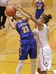 Eastwood's Kaylee Martinez is defended by El Dorado's Ebonie Ballesteros in the second half of their game Tuesday.