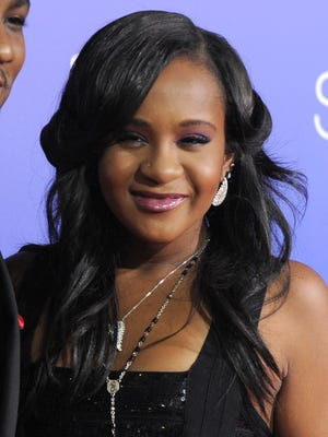 """In this Aug. 16, 2012, file photo, Bobbi Kristina Brown attends the Los Angeles premiere of """"Sparkle"""" at Grauman's Chinese Theatre in Los Angeles."""
