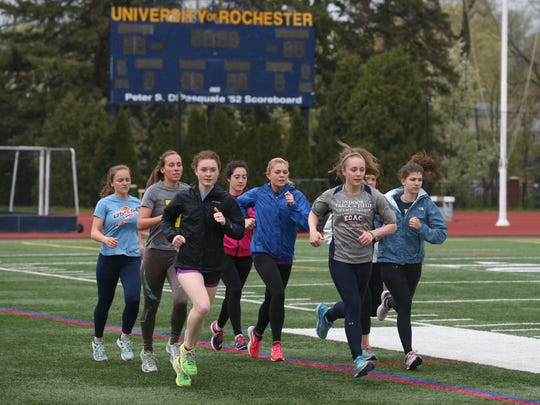 University of Rochester senior Laura Lockard, front second from right, practices with her teammates earlier this month at Fauver Stadium.