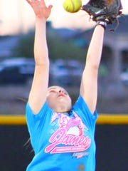 Taylor Murphy leaps for a line drive during practice Wednesday evening at the Grady Fields.