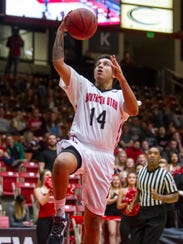 Southern Utah guard James McGee (14) goes up for a