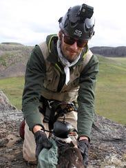 Myles Lamont, a Canadian wildlife biologist, holds