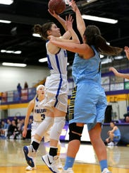 Amherst player Lauren Boelte attempts to score during