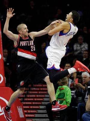 The Trail Blazers' Steve Blake blocks a shot by the 76ers' Michael Carter-Williams during the first half Monday at the Wells Fargo Center in Philadelphia.
