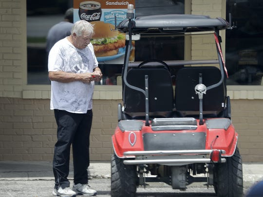 Don Christy was back on his red golf cart Wednesday, July 6, 2016, in Sheridan, Ind. But this time he wasn't toting any political statements or opinions.